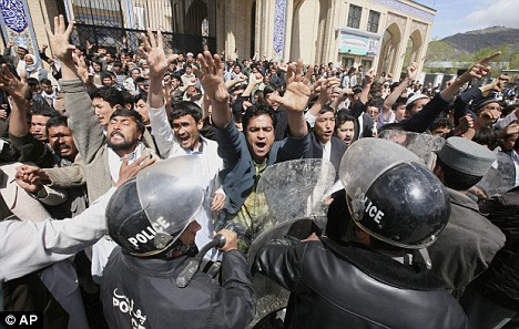 Tensions: Rival protesters have to be kept away from the women by riot police