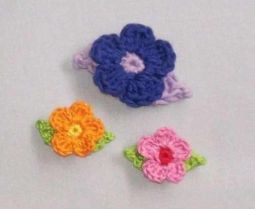These are just adorable!  Add them to jeans, purses, bookmarks, headbands...