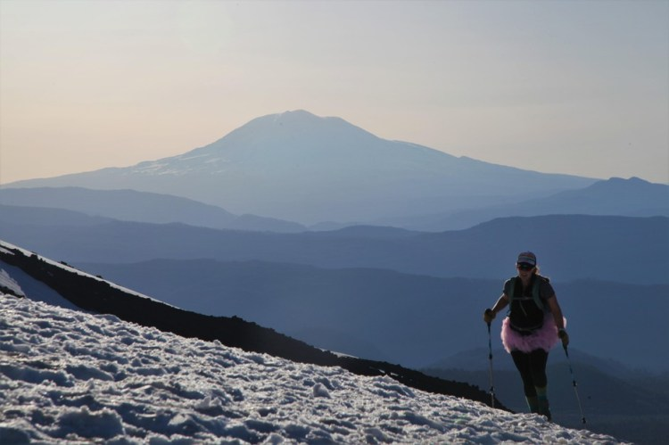 A woman in a pink tutu climbs Mount St. Helens on Mother's Day, following a tradition started by Kathy Phibbs.