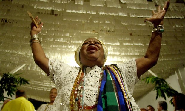 chair dance ritual song swing in karachi candomble the of orixas a glimpse at traditional baiana woman performs honor to omolu spirit syncretized with saint lazarus inside st church salvador