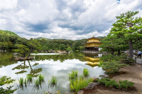 This is a caption of the Golden Pagoda. The best picture I could get, considering the huge amount of tourists gathered around the lake. Kyoto, Japan.