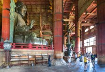 This enormous statue of Buddha in Tōdai-ji東大寺, Nara, gave me a hard time to find the right angle for the photo. Its size and surrounding columns give very little room for a correct frame. It is the world's largest bronze statue of the Buddha. I believe by having people in the frame I give an idea of the gigantic proportions. Nara, Japan.