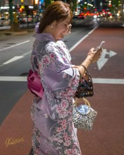 Yes, even Yukata girls check on their cellphone. Street photography is tricky. So many oportunities I lost in my recent trip in Japan. If you are not fast enough the moment is gone, so is the photo. This time I had my camera ready for action. Tokyo Street, Japan.