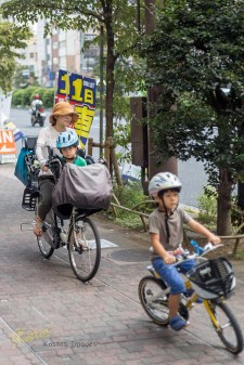 Apologies for the privacy invasion, but these ladies deserve to be posted. Bicycle riding in all ages, forms and reasons. Tokyo, Japan.