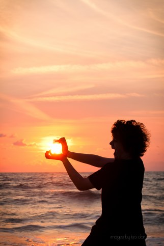 my son, dylan, playing with the sunrise...9/2/12
