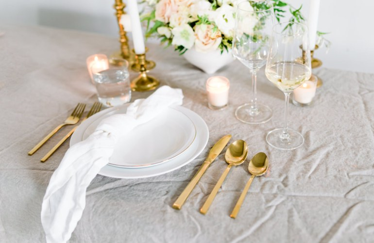 A place setting with gold silverware showcased at Small Business Brand Photo Session