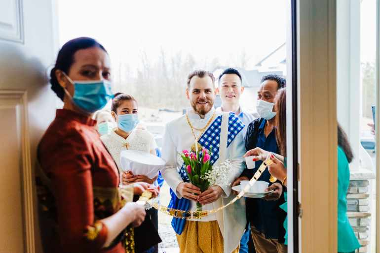 Groom enters home as Traditional Lao wedding ceremony takes place in St. Michael, Minnesota