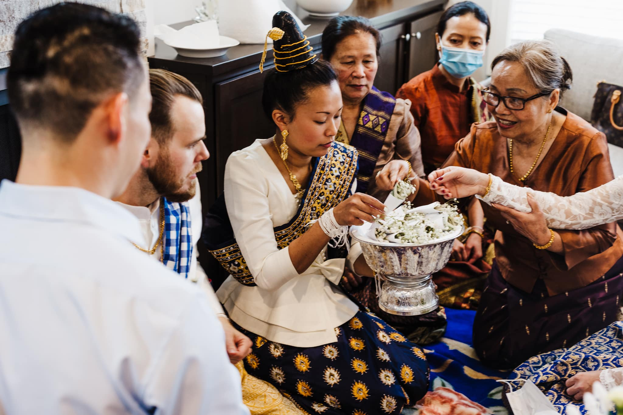 Couple celebrates their traditional Lao wedding ceremony in St. Michael, Minnesota