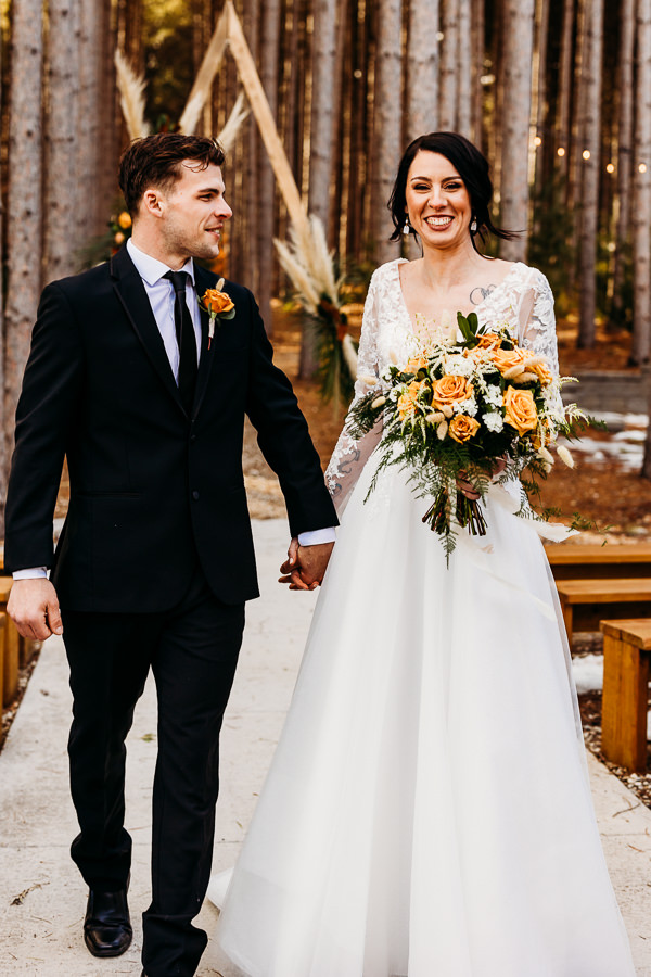 Couples celebrates their wedding at one of the top minnesota wedding venues at pinewood weddings and events