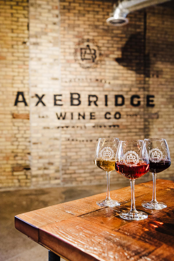 Photos of wine glasses on a table during Minneapolis Urban Winery Branding session