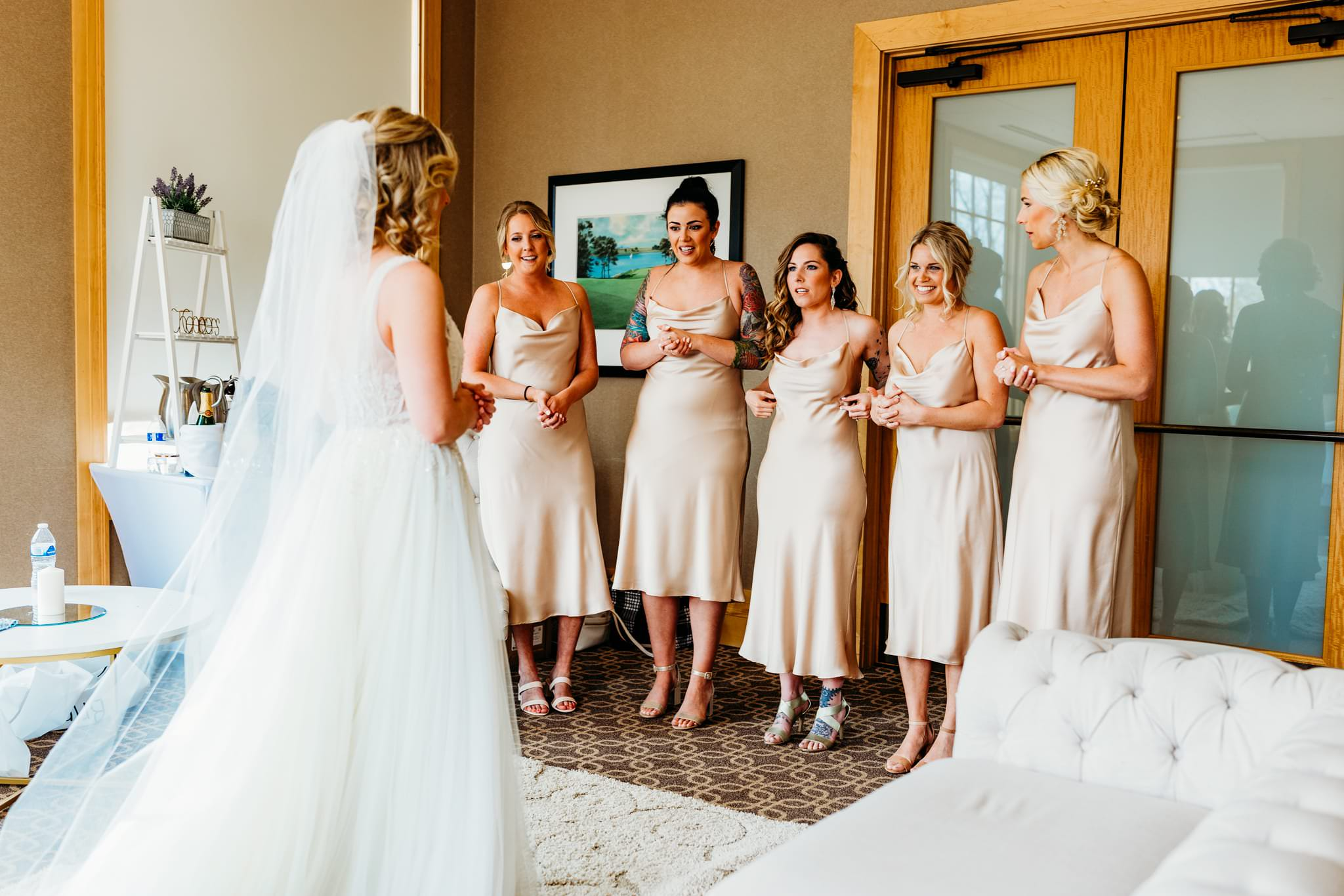 Minneapolis wedding photographer captures the moment bridesmaids see the bride in her dress for the first time.