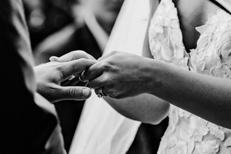 Couple exchanges rings at their schroeder farms wedding captured by Minneapolis Wedding Photographer