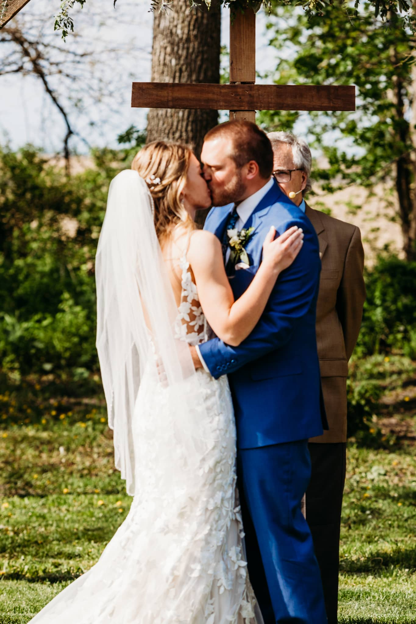 Couple has their first kiss during their ceremony at their Schroeder Farm wedding