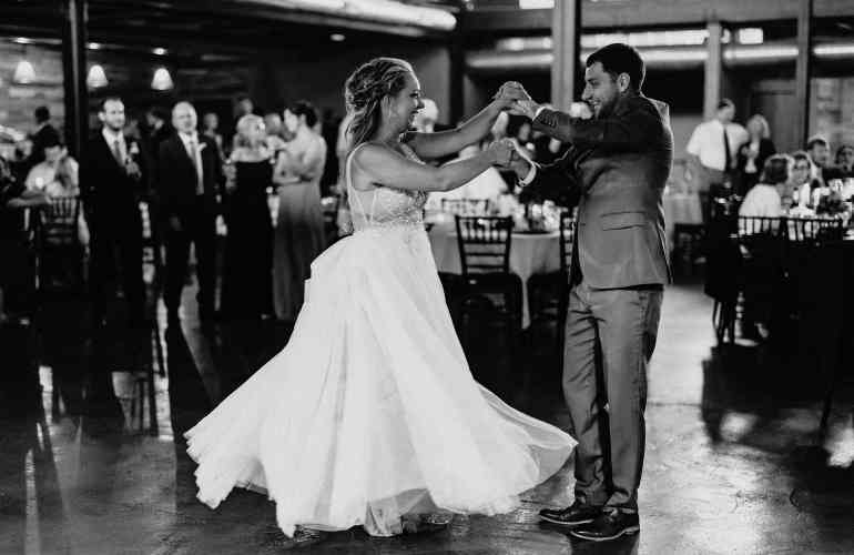 Bride and groom dancing in a black and white photo at their Duluth Malting Building Wedding