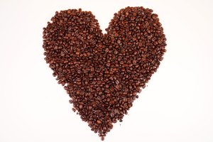Coffee beans in heart-shaped top view