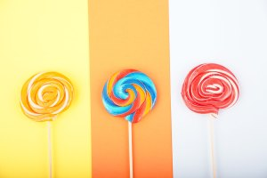 Lollipops on colorful background