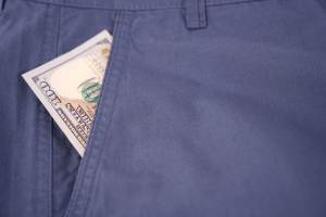 Dollar banknotes in pocket