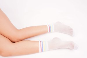 Young female legs in white socks