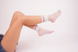 Young female wears fashionable white socks