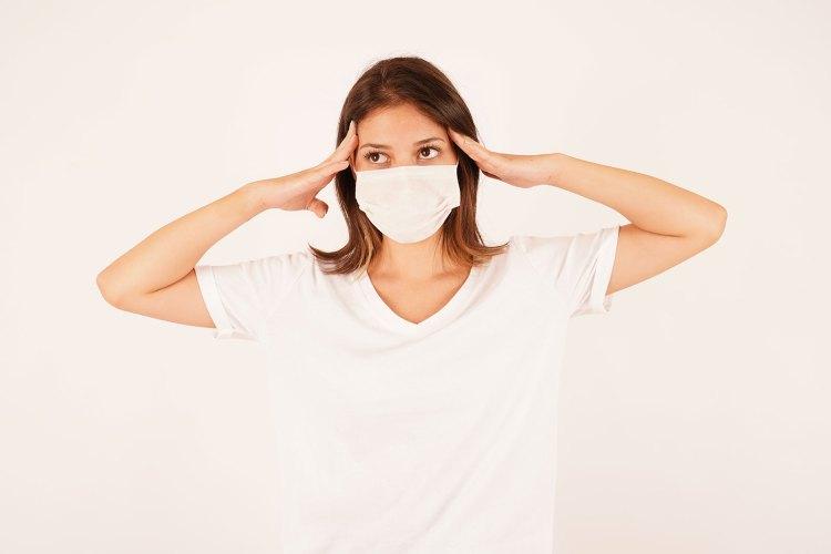 Anxious woman wearing medical mask