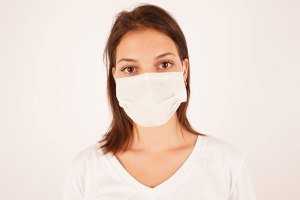 Woman portrait with a surgical mask