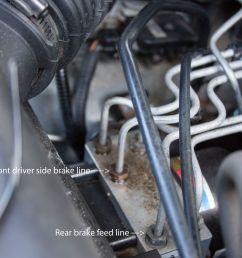 here is my issue now i took the one bolt off holding this clip in place which holds the front feeder brake line in place and you can see in the pic  [ 4388 x 2856 Pixel ]