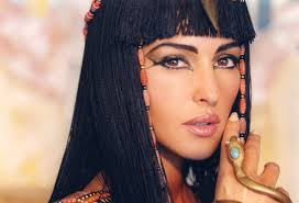 Classic Egyptian eye makeup... defining the eye, adding embellishment at the outer corner of the eye.