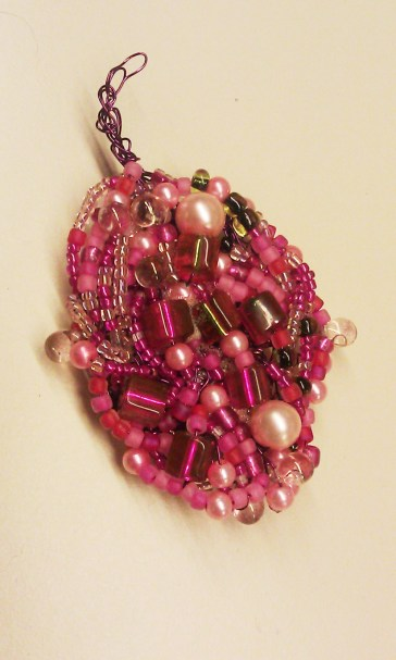pearls, fire polished czech glass, czech teardrop beads and seed beads make up this leaf.