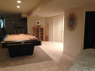 looking from the bed, pool table if we wished, and bath room is around the right side.