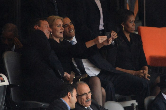 12. Roberto Schmidt, photograph of a selfie being taken by the Danish prime minister Helle Thorning-Schmidt, with Barack Obama and David Cameron, during a ceremony in honor of Nelson Mandela, December 11, 2013 (AFP).