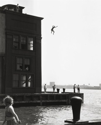 "A handout photo shows a 1948 gelatin silver print taken by Ruth Orkin named ""Boy Jumping into Hudson River""."
