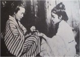 A young woman being tattooed with Okinawan hajichi (a practice outlawed in 1899)-1919