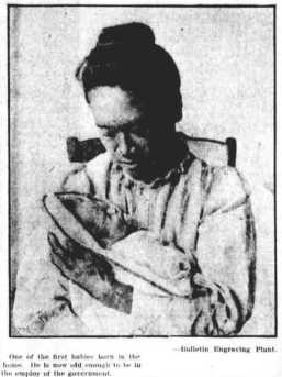 A_Woman_with_a_Baby_at_the_Kapiolani_Maternity_Home-1912