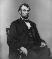 Abraham_Lincoln_seated,_Feb_9,_1864