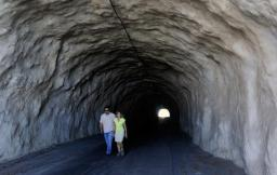 Brian Miyamoto of Hawaii Civil Defense and Denby Fawcett walk through the Kapahulu or Mule Tunnel-StarAdv