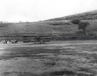 Bud Mars biplane on grass at Moanalua Field where approximately 3,000 people witnessed the 1st flight of a heavier than air machine over Hawaii soil.