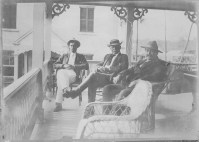 Chris J. Willis, John Maguire, and his son Charles Maguire-on_Hulihee_Palace-Lanai-(HSA)-PP-97-1-025