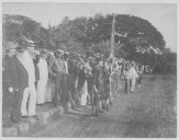 Dole,_Capt._Wiltse,_and_others_watching_a_parade_near_Iolani_Palace_following_overthrow_(PP-36-3-006)-WC