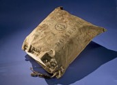 Early air mail was placed in heavy canvas bags and carried inside a special compartment in front of the pilot