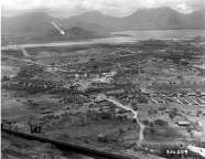 Fort Hase from the southwest rim of Ulupau Head. Arrow points to BCN 405-Bennett