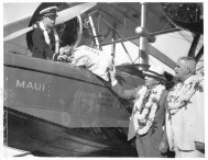 Gov. Joseph B. Poindexter hands mail bag to Inter-Island Airways co-pilot James Hoff for neighbor island delivery-PP-1-4-008-Oct_8,_1934