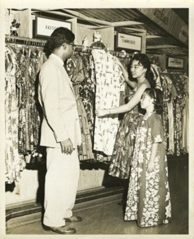 Gulab Watumull speaking with customers. Photo credited to Honolulu Star-Bulletin.-SAADA