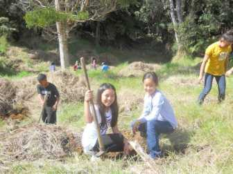 Happy-students-plant-seedling-HFI