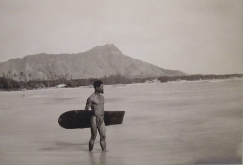 Hawaiian_with_surfboard_and_Diamond_Head_in_the_background-1890