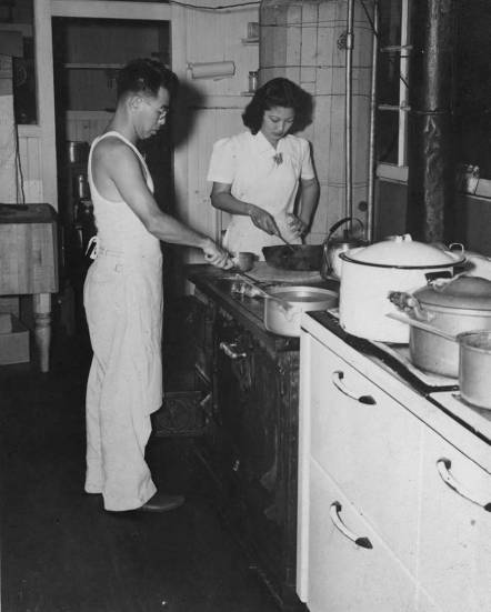 Hotel-Honokaa-Club-Victor Morita preparing food in the kitchen with unidentified waitress, ca. 1940s