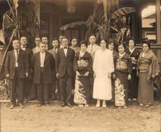 Hotel-Honokaa-Club-Victor (left of center) and Tomiko (right of center) Morita's wedding party. Mother Kane Morita is in white, ca. 1920s
