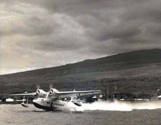 US mail plane takes off from historic Kailua Bay, Island of Hawaii, landing place of pioneer American missionaries over 100 years ago.