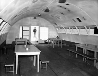 Interior of a floating Quonset hut, possibly serving as an Officer's Club in the 1940s