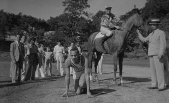 Track star Jesse Owens is shown on the starting line just before he raced a horse at Tropical Park on December 26, 1936. Owens ran 100 yards in 9.9 finishing 20 yards ahead of the horse who was handicapped 40 yards at the start. (AP Photo)