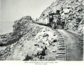 Kinau-nearing Mahukona with a narrow gauge train loaded with sugar - 1882